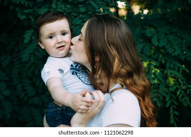 Happy mother kisses her daughter.