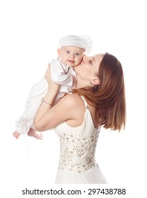 Happy mother kissing her firstborn. Isolated on white background. The concept of happiness is having children.