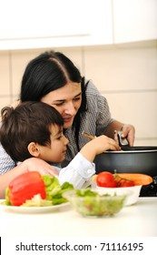 Happy mother and little son in the kitchen, happy time and togetherness