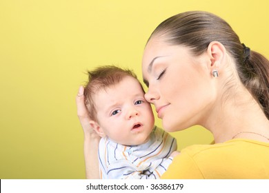 happy mother with newborn baby isolated