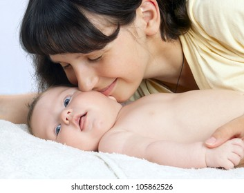 happy mother playing with baby