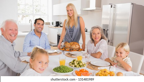 Happy mother serving a turkey for thanksgiving