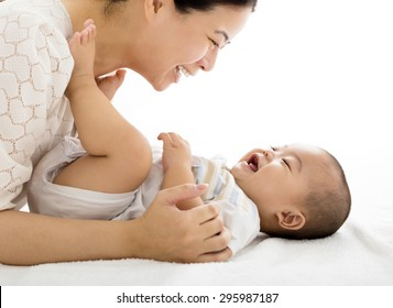 happy mother with smiling baby boy