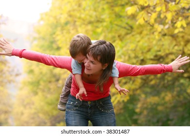 happy mother and son in autumn park