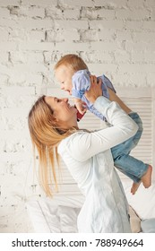 Happy Mother and Son Having Fun at Home. Cute Woman and Child, Parental Love and Care Concept