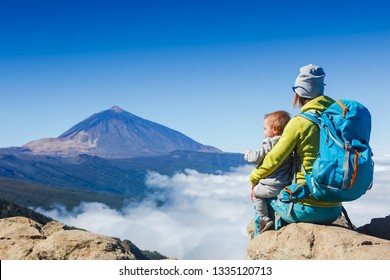 Happy mother and son travel together and anjoying the view. Teide volcano on Tenerife island. Family trip in the mountains, vacation with infant