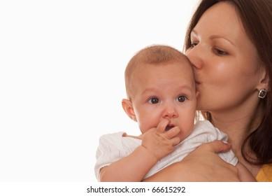 happy mother in yellow holding beautiful newborn