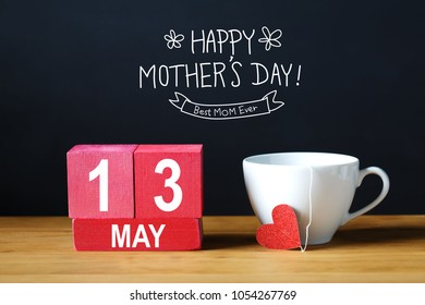 Happy Mothers Day 13 May message with coffee cup with wooden blocks