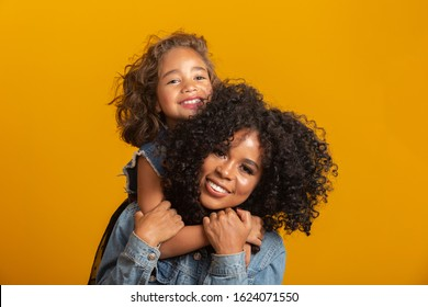 happy mother's day! Adorable sweet young afro-american mother with cute little daugh.