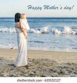 Happy Mother's day background with Mother and daughter on the sandy beach near ocean in sunny day
