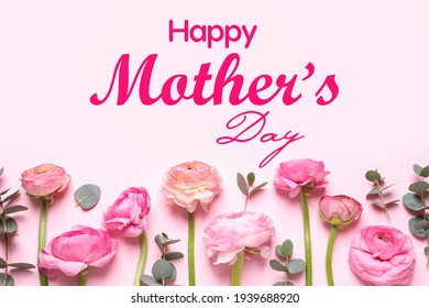 Happy Mother's Day. Beautiful ranunculus flowers on light pink background, flat lay