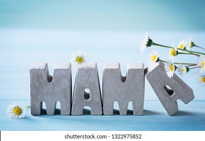 Happy Mother's Day - Concrete letters saying the word Mama, decorated with daisys