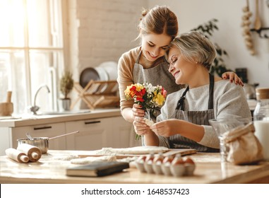 happy mother's day! family old grandmother mother-in-law and daughter-in-law daughter congratulate on the holiday, give flowers
