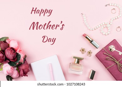 Happy Mother's Day greeting card with fashion accessories in background.