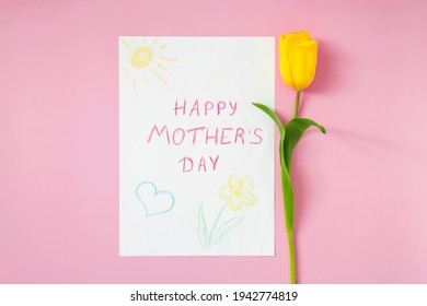 """""""Happy mother's day"""" greeting card for Mom drawn by kid on Mother's Day with yellow tulip on pastel pink background. Congratulations and greetings for Mom on special day. Minimalism."""