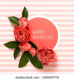 Happy Mother's Day Living Coral Pantone Color Background. Coral flat lay greeting card with beautiful roses.