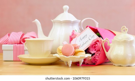 Happy Mother's Day tea setting with teapot, macaron cookies, pink roses and gift.