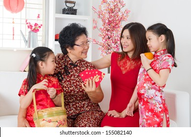 Happy multi generations Asian family celebrate Chinese new year at home.
