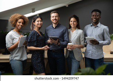 Happy multiethnic business team african asian caucasian office people stand together looking at camera, smiling confident diverse professional colleagues group international staff corporate portrait