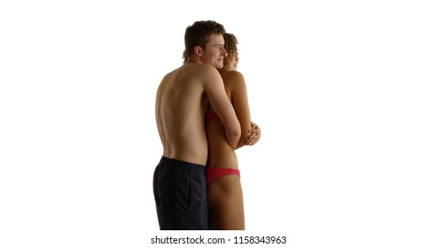 Happy multiethnic couple embracing in swim wear isolated on white background