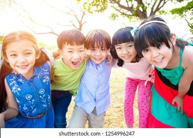 happy Multi-ethnic group of schoolchildren in park