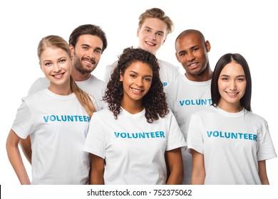 happy multiethnic group of volunteers isolated on white