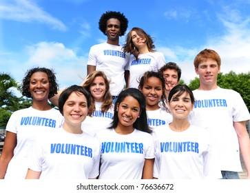 happy multi-ethnic volunteer group outdoors