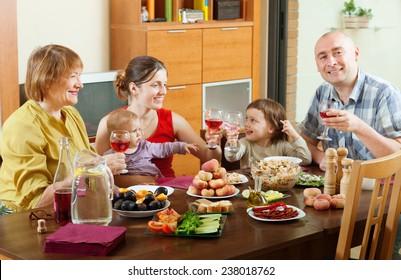 happy multigeneration family communicate around festive table