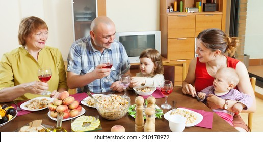happy multigeneration family communicate over holiday table at home