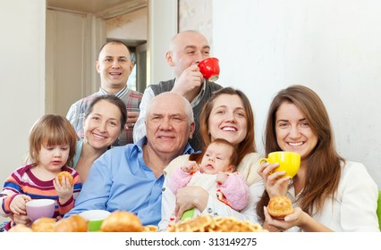 happy multigeneration family communicate over tea at home