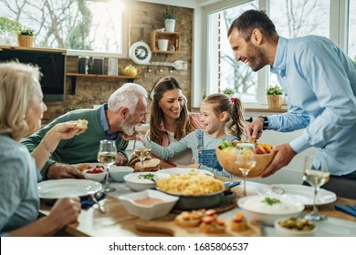Happy multi-generation family gathering around dining table and having fun during a lunch.  - Shutterstock ID 1685806537
