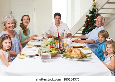 Happy multigeneration family having Christmas meal together at dining table