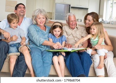 Family reading together images stock photos vectors shutterstock happy multigeneration family reading storybook in living room at home sciox Gallery