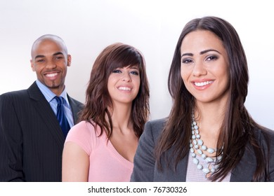 Happy multiracial business team, three young smiling people.