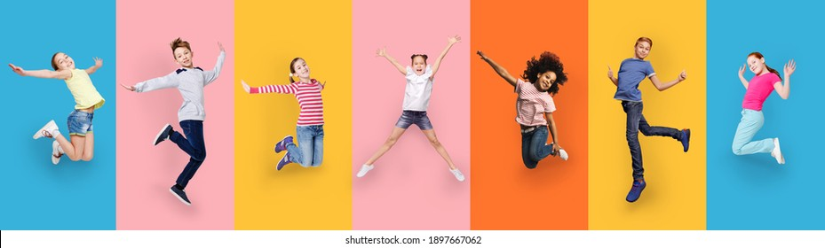 Happy Multiracial Children Jumping Posing On Different Colored Backgrounds. Row Collage With Carefree Kids, Cheerful Boys And Girls Jump In Studio. Joyful Childhood And Fashion Concept. Panorama
