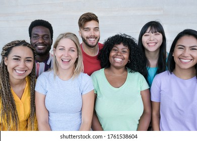 Happy multiracial friends laughing - Group of young peoples having fun together - Concept of no racism