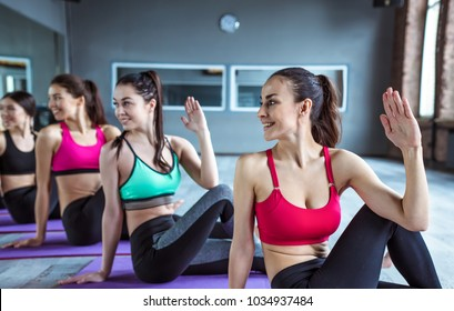 Happy Multiracial Group Of Young Smiling Beautiful Women In Sportswear Doing Yoga Exercises Class