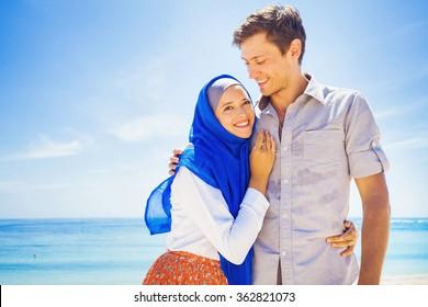 Happy Muslim Couple On A Beach