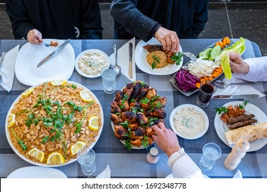 happy muslim family eating togther