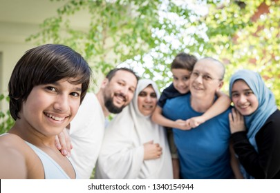 Happy Muslim family selfie portrait