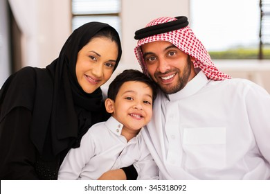 happy muslim family spending time together at home