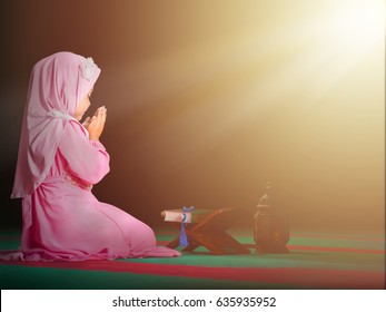 happy muslim girl with full hijab in pink dress , asian traditional style dress , praying  inside the mosque and holy Allah