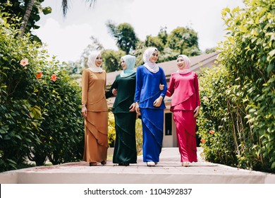 Happy muslim girls during Eid ul Fitr celebration.Attractive young muslim girl hijab fashion.Muslim girl wearing baju kurung and hijab during ramada and eid ul fitr celebration.