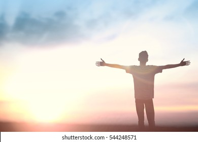 Happy muslim man reborn to worship god on morning background. Christian praise and pray for hope in sunset, educate concept for peace energy in bible, freedom financial, self vision inspiration