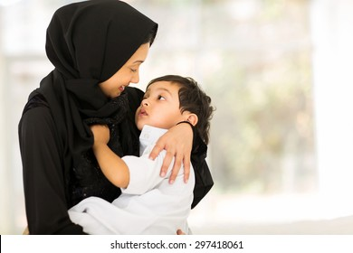 happy muslim mother and baby boy