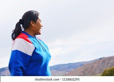 Happy native american woman admiring the nature.
