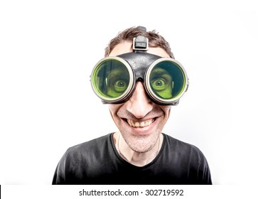 Happy nerdy guy in green vintage goggles.