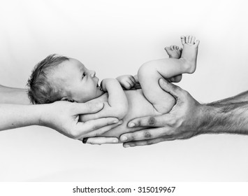 Happy new born Baby in hands of parents
