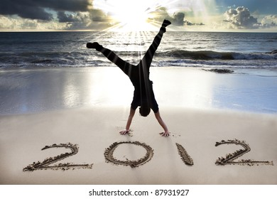 happy new year 2012 on the beach with sunrise background