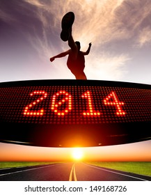 happy new year 2014.runner jumping and crossing over matrix display for celebrating 2014